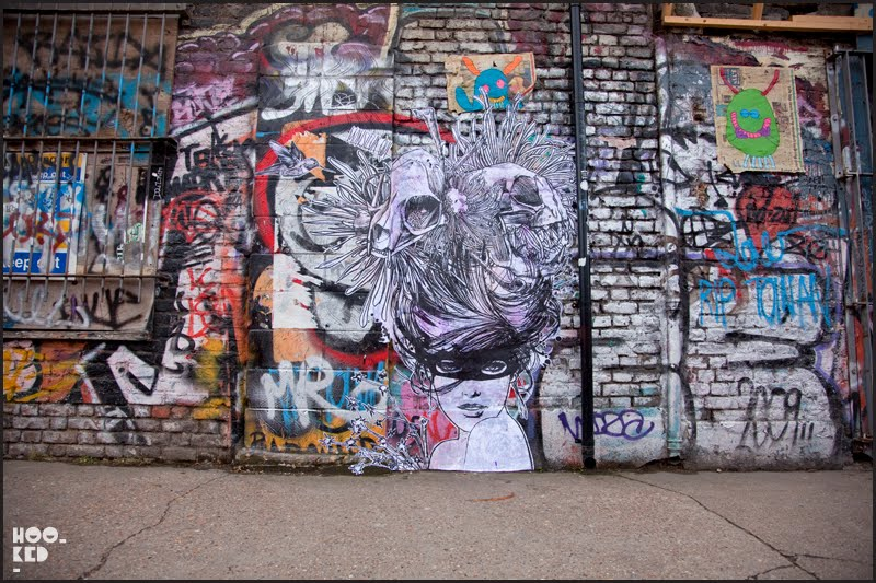 Large scale London street art paste-up by artist Monsieur Q on Sclater Street