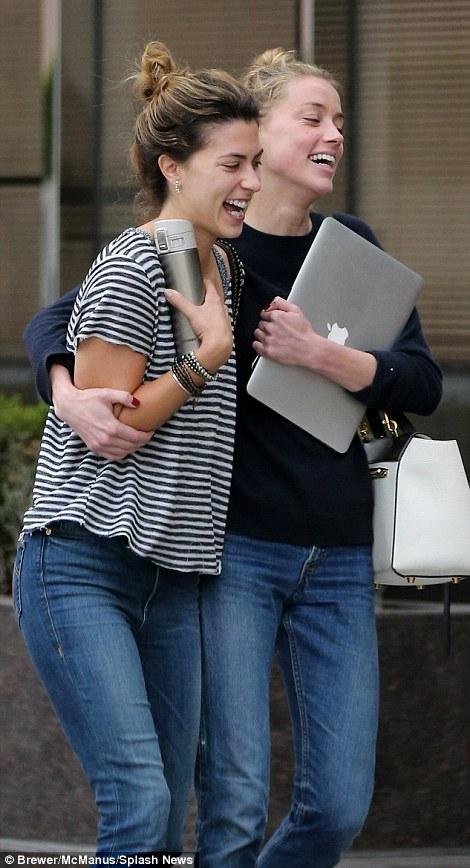amber Heard laughing divorce court