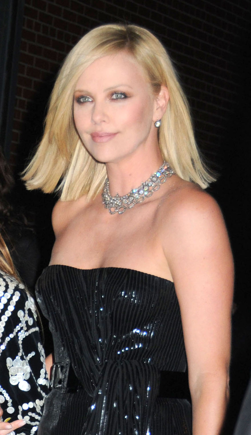 Hollywood Actress Charlize Theron Dazzling In A Black Dress