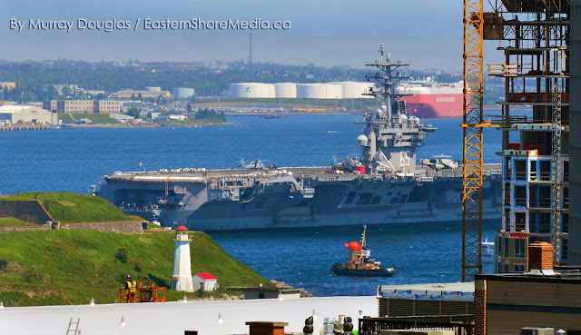 Theodore Too tugboat greets the USS Dwight D Eisenhower in Halifax, Nova Scotia