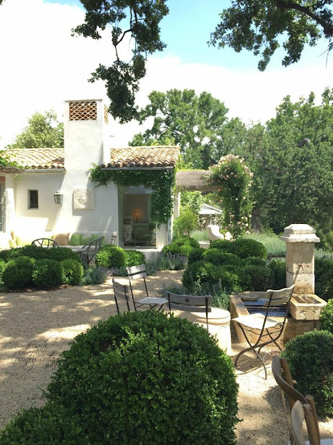 Garden areas with boxwood and french style seating and fountain
