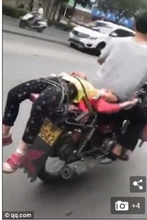 Father Ties His Crying Daughter On Motorcycle And Drives Her To School After She Stubbornly Refused To Go (Photos)