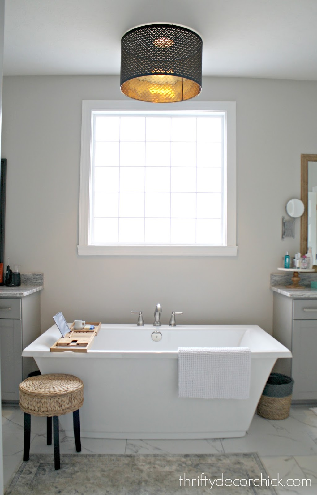 Black drum shade over tub