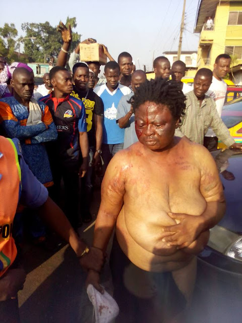 Graphic Photos: Suspected Female Kidnapper Stripped And Beaten By Angry Mob