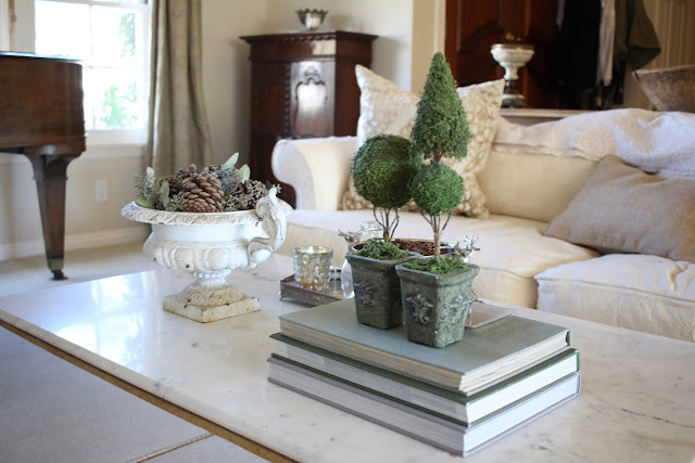 styling a coffee table fall christmas pinecones antique urn