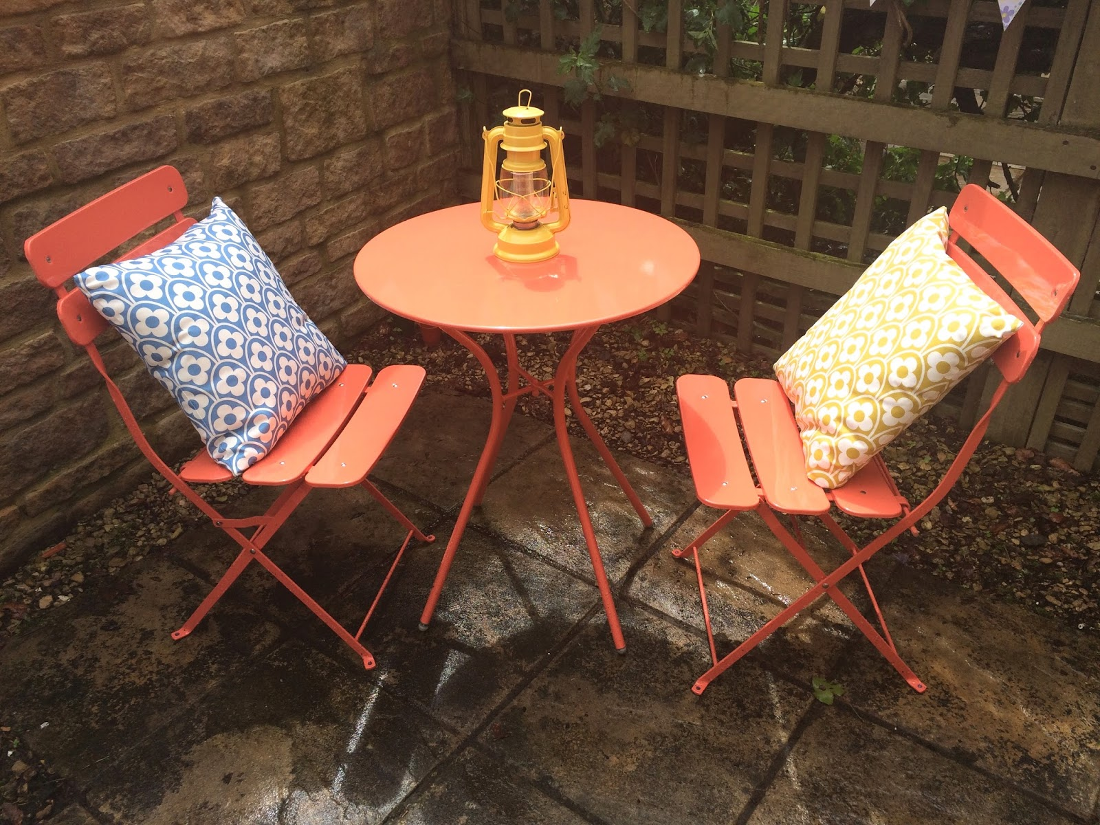 as a seating area i chose this bistro set from the homebase garden furniture range i love the coral colour its so bright and is perfect for summer - Garden Furniture Kerry