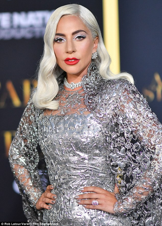 Lady Gaga stuns in a silver gown as she attends the premiere of A Star Is Born alongside Bradley Cooper