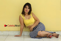 Cute Telugu Actress Shunaya Solanki High Definition Spicy Pos in Yellow Top and Skirt  0289.JPG