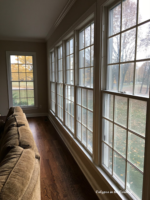 Wall of Windows in Family Room before Plantation Shutters installed