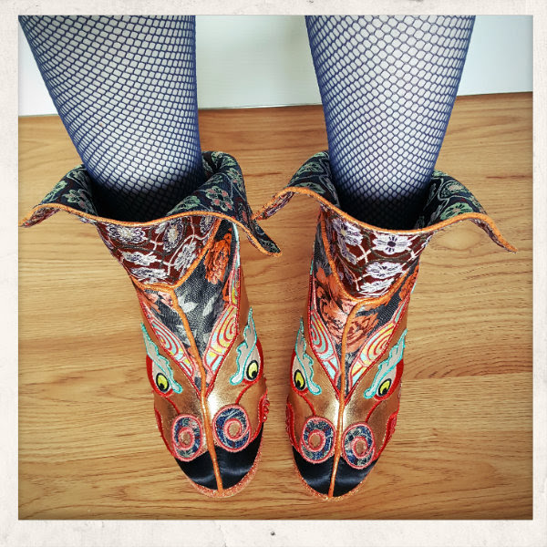 wearing Irregular Choice Tatsu ankle boots in different ways with cuff flicked