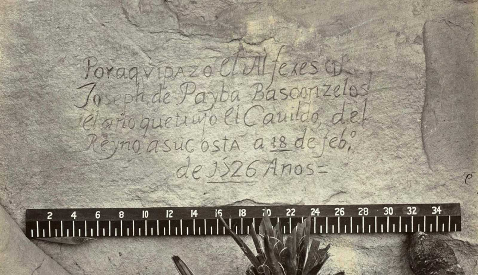 Nearly 150 years ago, photographer O'Sullivan came across this evidence of a visitor to the West that preceded his own expedition by another 150 years -- A Spanish inscription from 1726. This close-up view of the inscription carved in the sandstone at Inscription Rock (El Morro National Monument), New Mexico reads, in English: