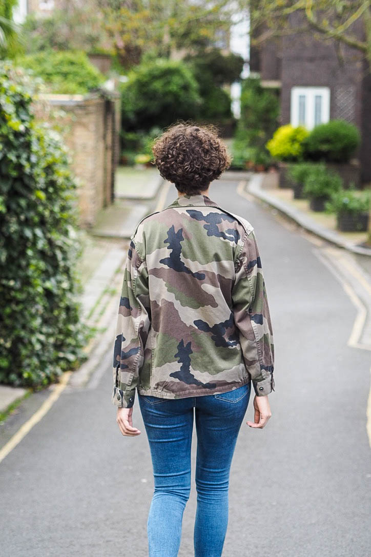 Fashion blogger in camo jacket, jeans