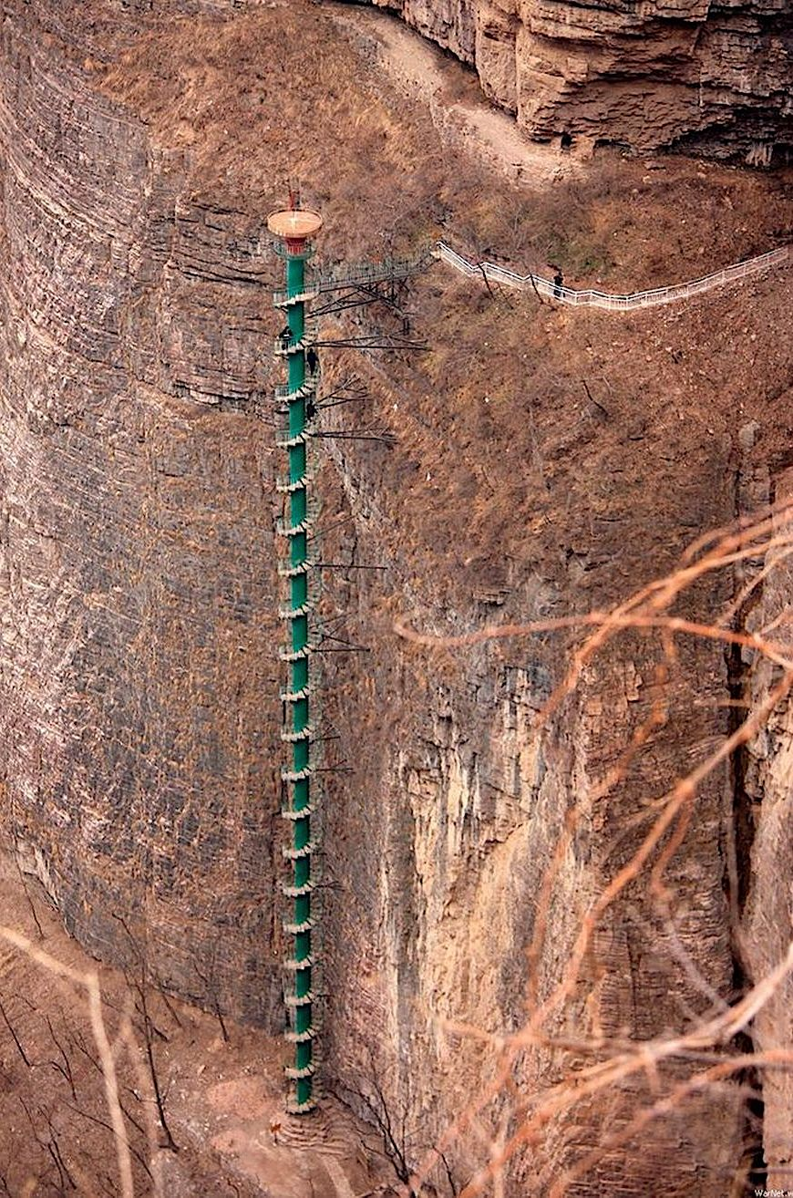 a spiral staircase cliff in China, color photograph