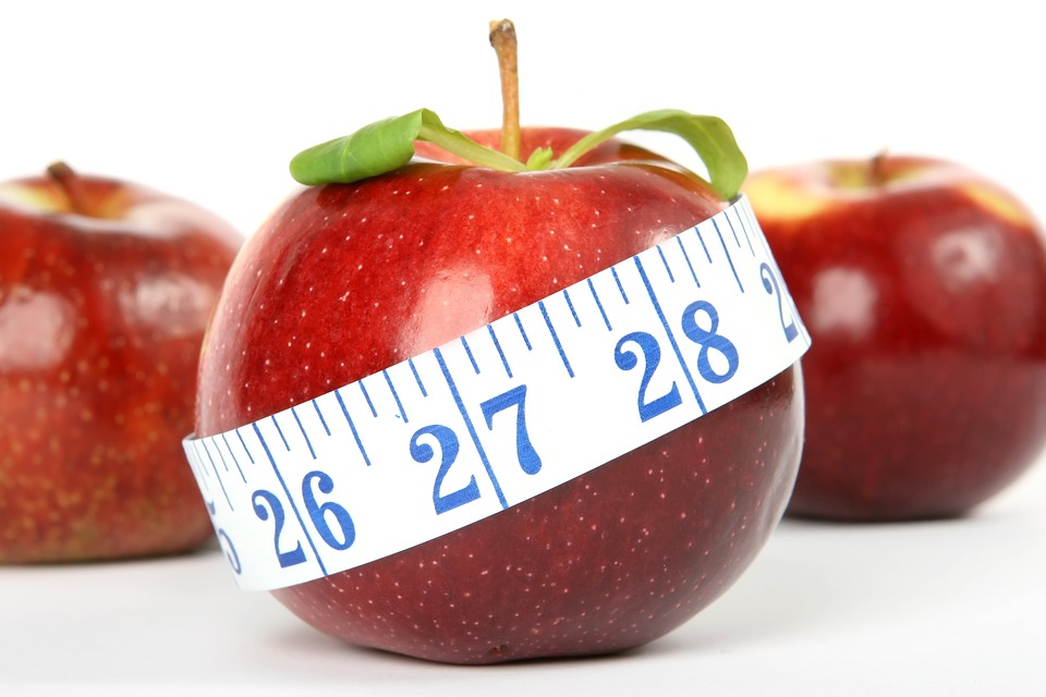 Dieting Mistakes That Could Slow Down Weight Loss apple with measuring tape Pixabay image