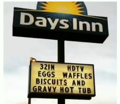 Hotel billboard advertising hotel amenities including: Eggs Waffles Biscuits and Gravy Hot Tub