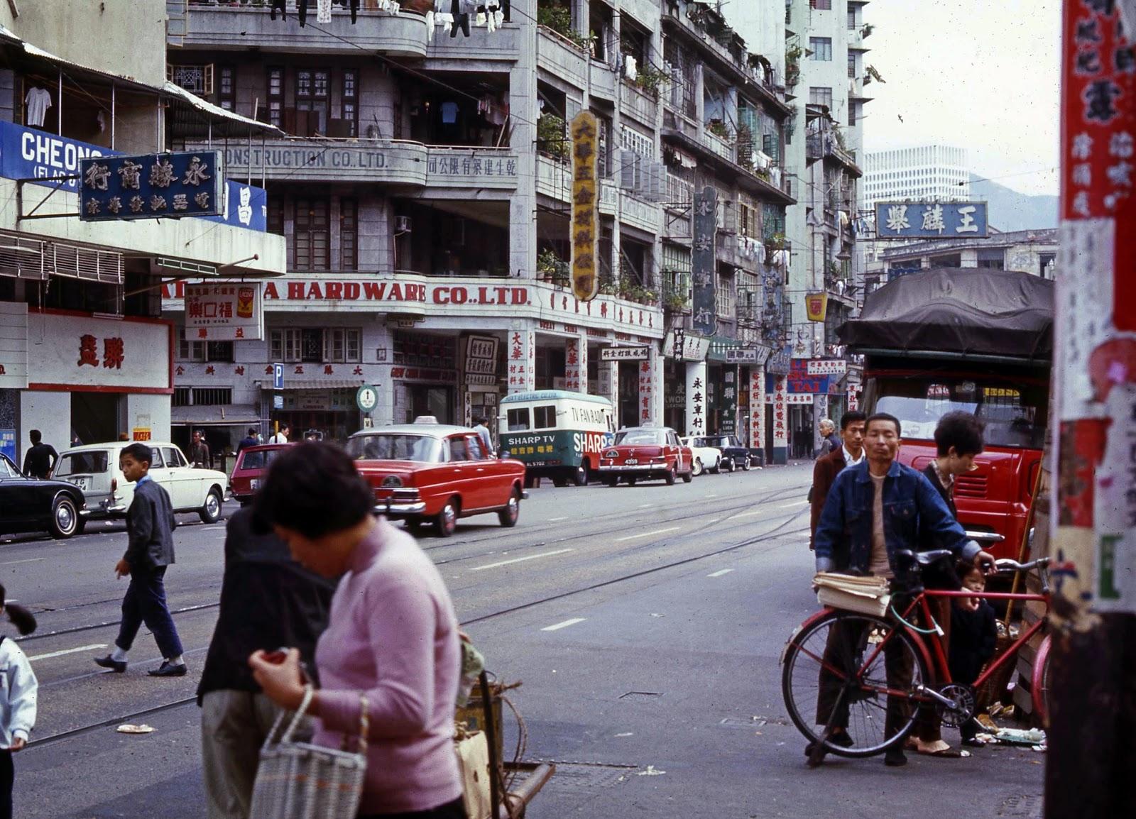 Busy Hong Kong Street, Mercedes Cabs and bicycles -  Hong Kong 1969