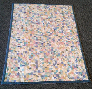 Postage stamp quilt from re purposed material