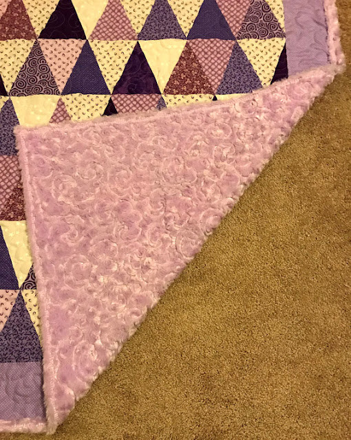 Soft and pretty purple quilt.