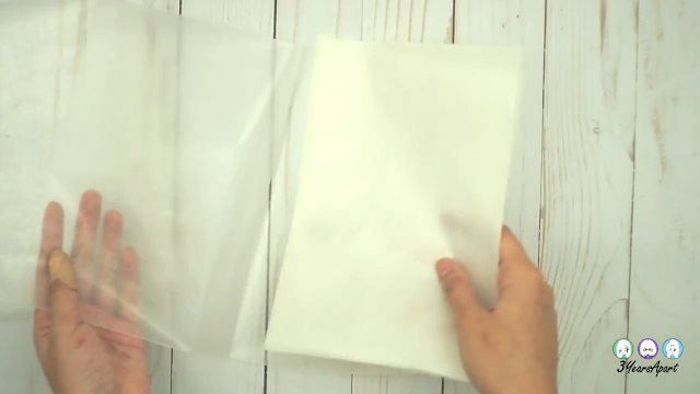 Assembling folded wax paper into a book.