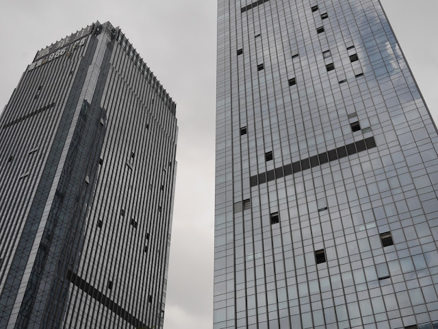 towers with missing windows at the Midtown urban complex in Zhuhai