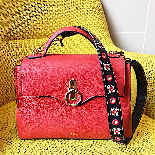 Mulberry Small Seaton Classic in hibiscus red teamed with the Mulberry Silky Calf Leather Geo Floral with Dots Shoulder Strap in midnight blue