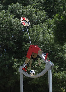 Wind-drive mobile figure of boy with soccer ball, Cardoza Park, Milpitas, California