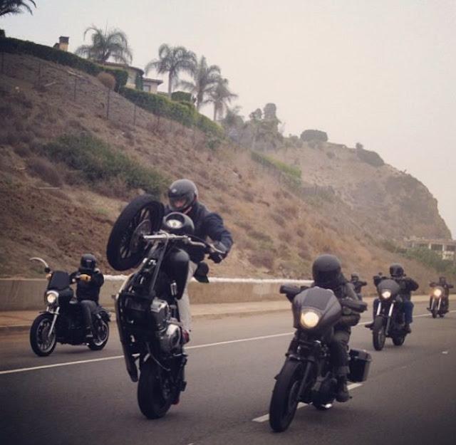 Matte black Harley Davidson Dyna wheelie.