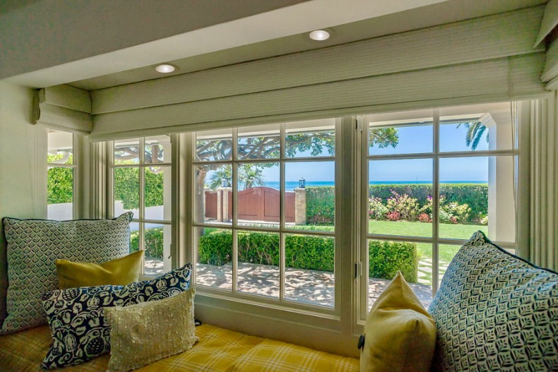 bright and cheery coastal spot in this window seat with an ocean view
