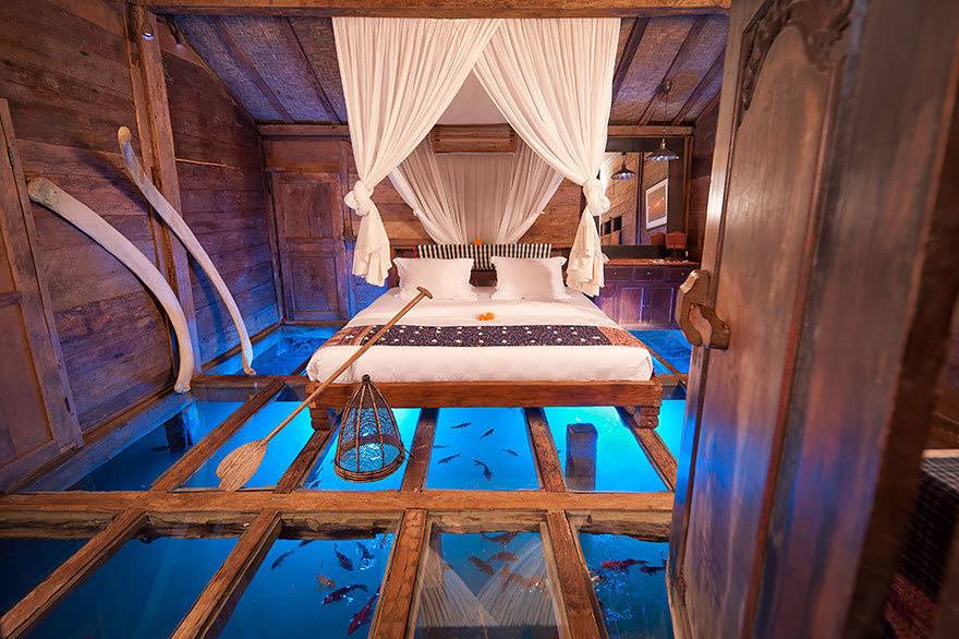 14 Crazy Hotels That Will Give You Serious Travel Goals - Glass Floor Udang House in Bali, Indonesia boasts incredible floors to the water, plus luxurious furniture for travelers to rest their weary heads.