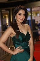 Raashi Khanna in Dark Green Sleeveless Strapless Deep neck Gown at 64th Jio Filmfare Awards South ~  Exclusive 101.JPG