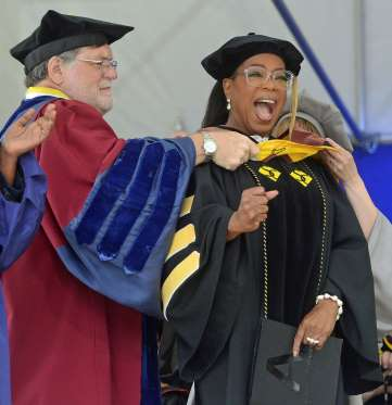 Oprah Winfrey tells grads to seek fulfillment in service (Photos)