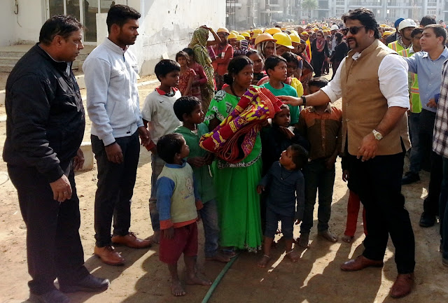 Mr Arman Chaudhary,Chief of HR,Emaar India at the Clothes  Distribution Drive for labourers at Palm Terraces Gurugram