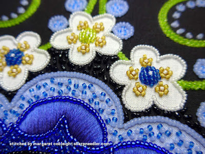 Starting to add black beaded background (para). (Wild Child Japanese Bead Embroidery by Mary Alice Sinton)