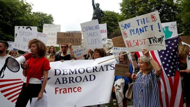 Hundreds of people protest US President Donald Trump's visit in French capital of Paris