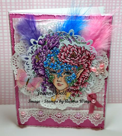 card with flowers, feathers, pink butterflies and coloured flora masquerade image