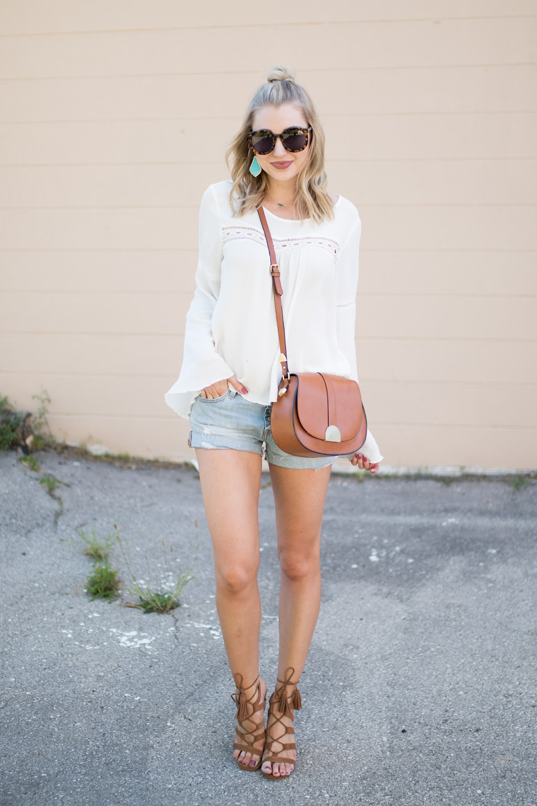 White top with Levi's shorts