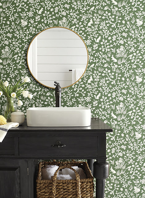 bathroom with green wallpaper and charcoal vanity