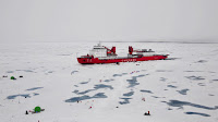 "Over the last decade, the Chinese National Arctic Research Expedition (CHINARE) and U.S. collaborators have studied the environmental and climate changes of the western Arctic Ocean and has witnessed rapid expansion of the ""acidified"" water in the upper water column. This photo shows the science team working on an ice station in front of the icebreaker XueLong during the summer 2010 cruise in the northern Canada Basin, very close to the North Pole. (Image Credit: University of Delaware) Click to Enlarge."
