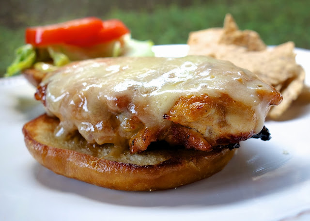Creole Honey Mustard Chicken Sandwich Recipe - chicken marinated in dijon mustard, honey, lemon juice and cajun seasoning - grill or pan sear chicken, top with cheese and serve on a pretzel bun. This is my favorite chicken sandwich - better than any restaurant!