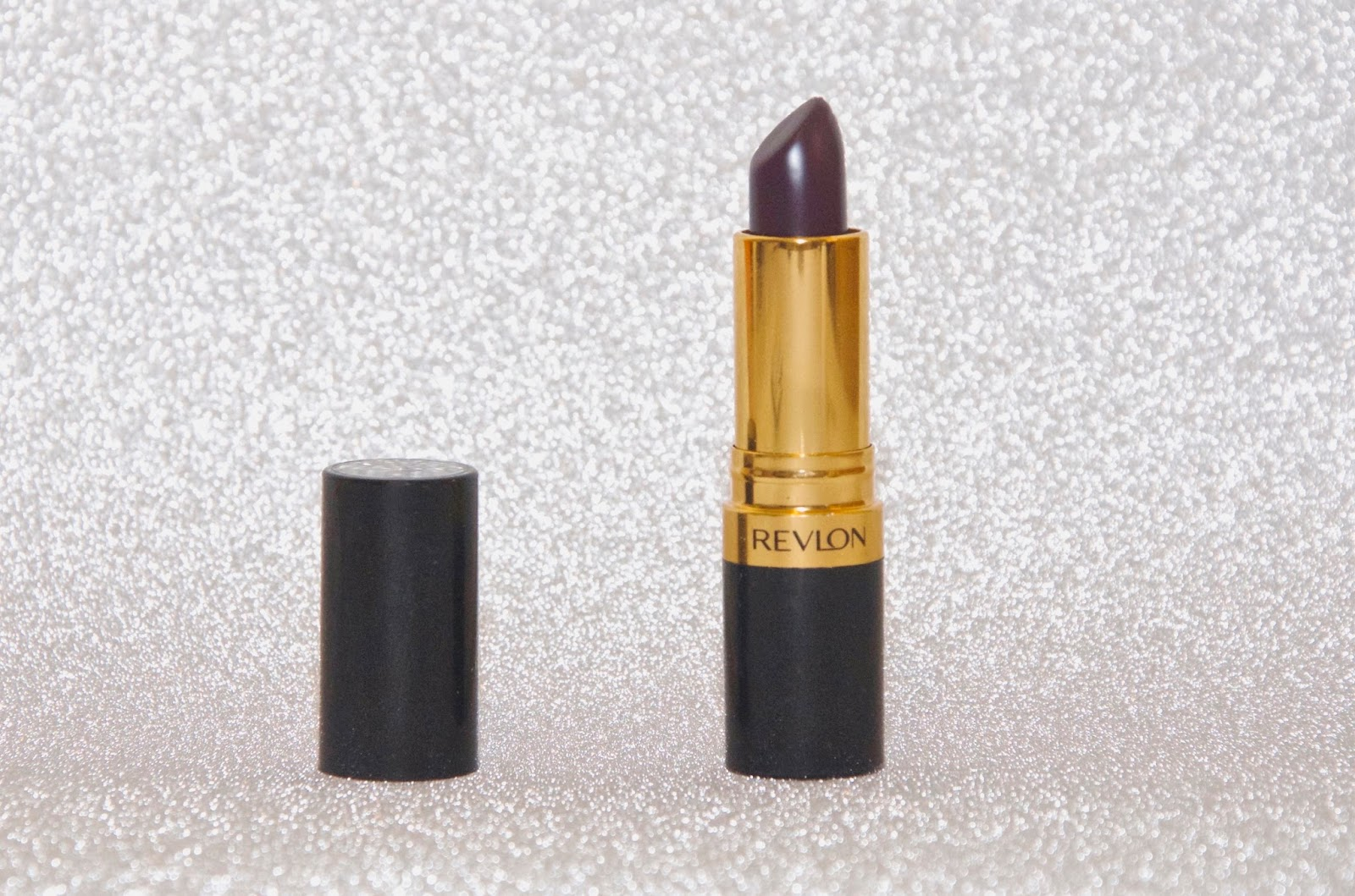 Revlon Super Lustrous Lipstick in Va Va Violet on Silver Glitter Background