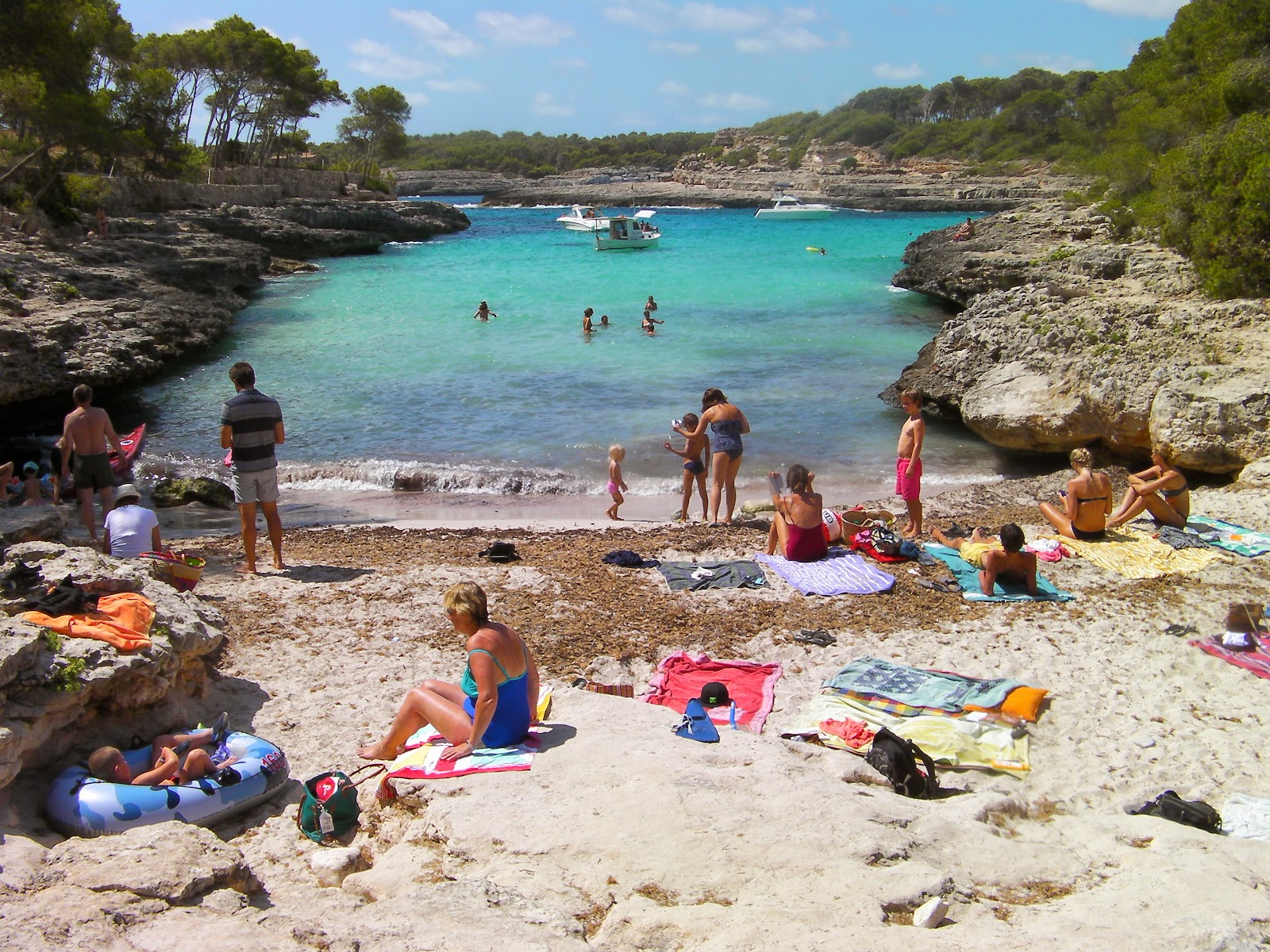 sheltered sandy beach scene sunbathers mondrago national park majorca