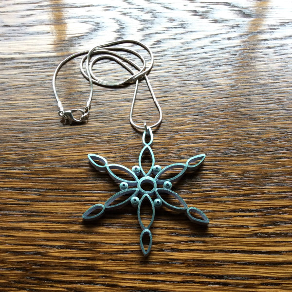 modern quilled snowflake with attached necklace chain
