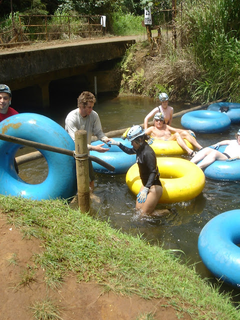 exiting the water on the Kauai Backcountry Tubing Adventure
