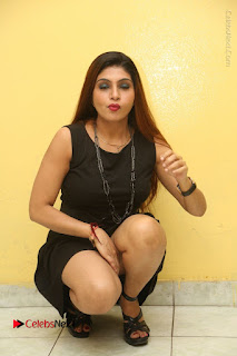 Tollywood Upcoming Actress Pooja Roshan Stills in Black Short Dress at Plus 1 Movie Trailer Launch  0243.JPG