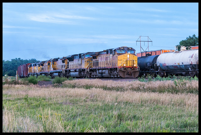 UP 7261 leads a manifest freight rain west on the Kearny Subdivison, at Brady, NE.