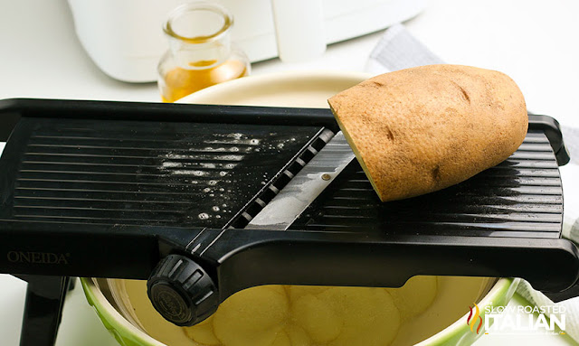 potato on a mandoline slicer