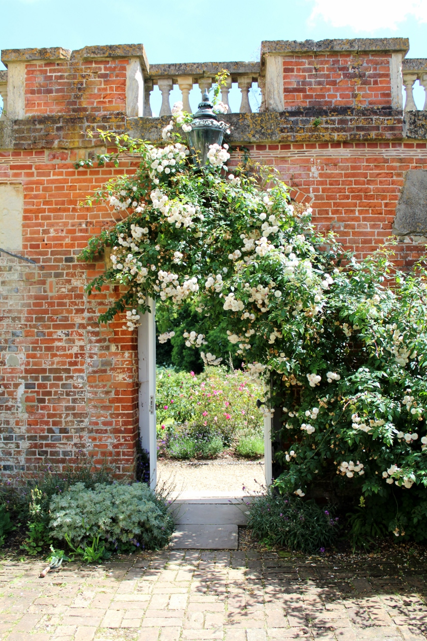 Flowers over brick archway at Basildon Park