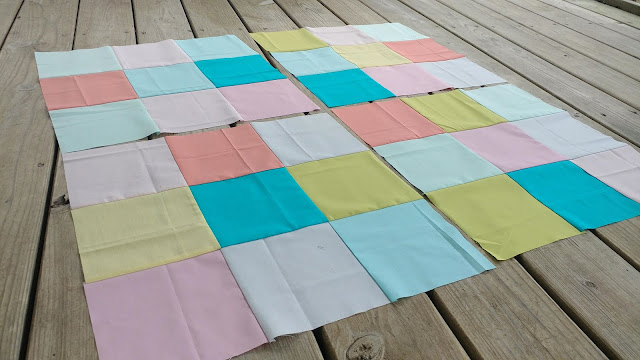 Nine patch blocks using Kona solids by Robert Kaufman