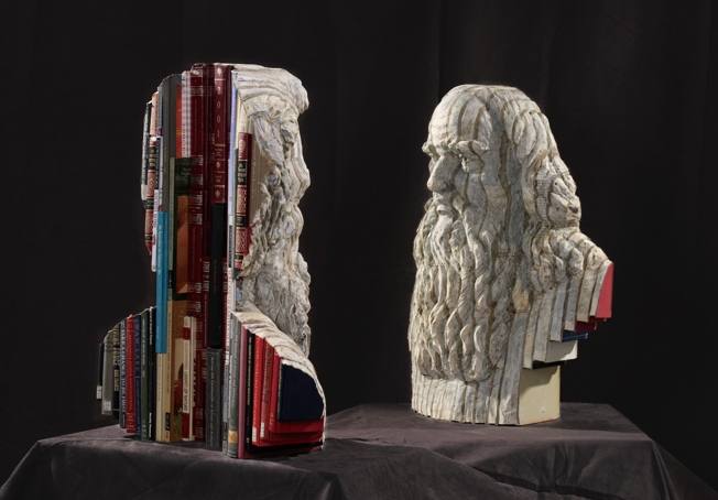 23-Renaissance-Man-Long-Bin-Chen-A-Second-Life-for-Recycled-Book-Sculpting-www-designstack-co