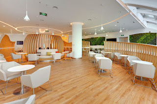 Curved woods adorn spacious seating areas at SkyTeam's Beijing lounge